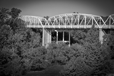 Built in 1923, this bridge is listed in the National Register of Historic Places. In 1958 it was bypassed by a larger bridge and converted to a pedestrian walkway.