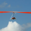 Hang glider at Cottesloe Beach. Maybe going to hang on the cloud for a rest.