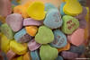 Candy Hearts<br /> These candy hearts are from our church Valentine's banquet used as a base in a vase holding a burning candle.