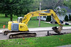 "Construction Destruction<br /> An excavator ( ""Kobelco 235SR LC Hydraulic Excavator"" <a href=""http://bit.ly/mOuCs3"">http://bit.ly/mOuCs3</a> ) at work out in front of MapleTronics."