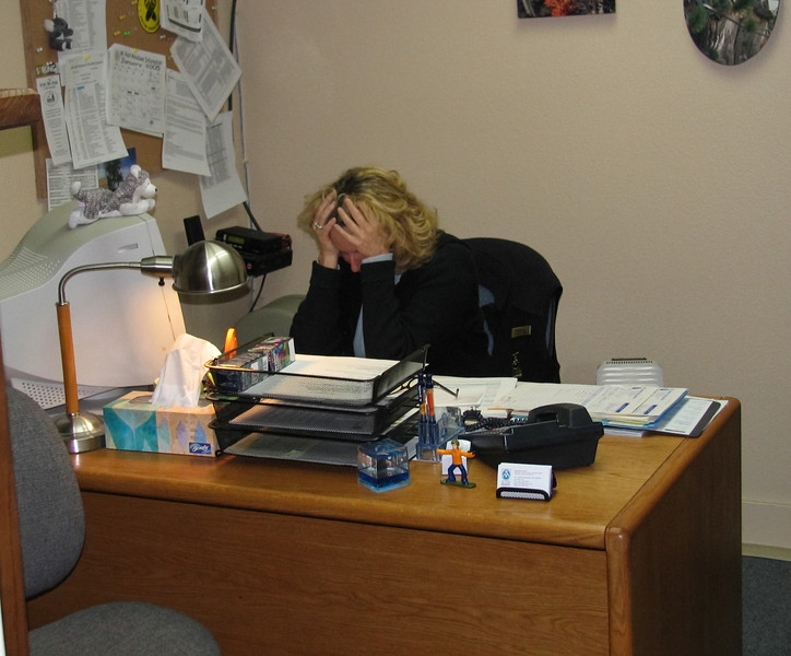 Marsha having a rough day at the office.<br /> <br /> Lens used: n/a (Canon S1 IS point-and-shoot)