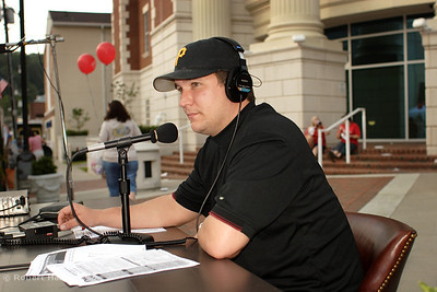 Brian Miliam broadcasts his sports call-in show from the festival  Thursday night