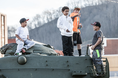 Boys Playing on a Tank