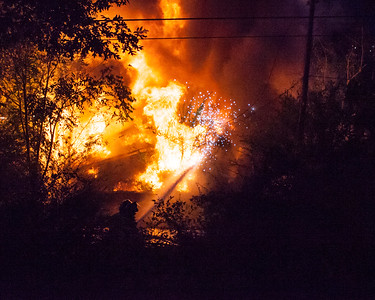 Firemen battle blaze as sparks fly