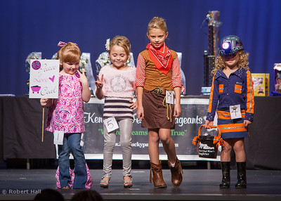 Children model costumes during a break in the pageant for the Black Gold Festival.