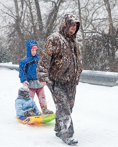 Sleigh riding family