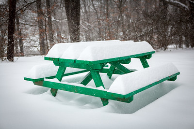 Snow-covered picnic table