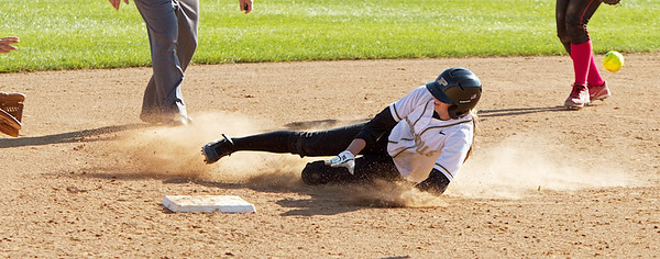 Freshman Ashley Burkhardt races the ball into second base.