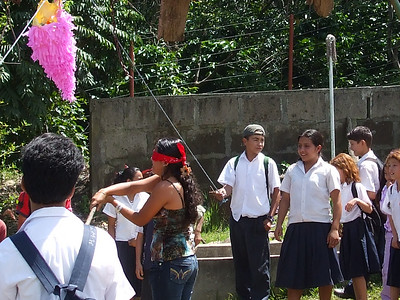 Teacher at her birthday party trying to break her pinata