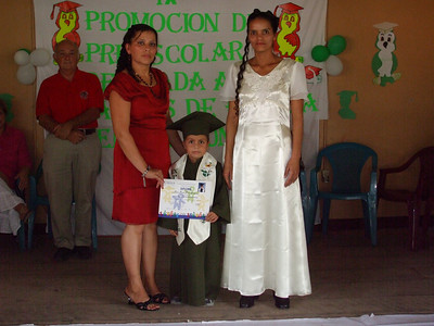 Teacher presenting diploma