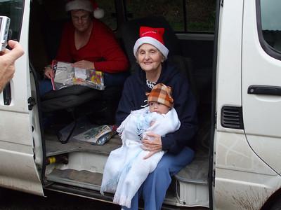 Giving Christmas boxes at Santa Inez