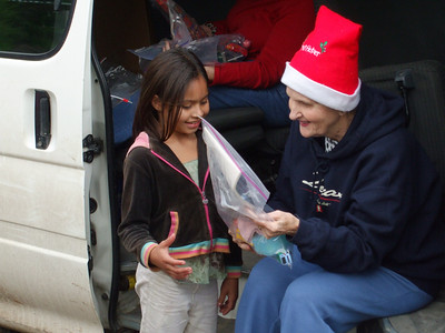 Giving Christmas boxes at Santa Inez