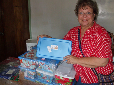 Ann holding Christmas box from our home congregation. Can you believe it.