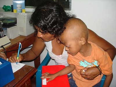 Rosalina signing our paperwork acknowledging she received the money.