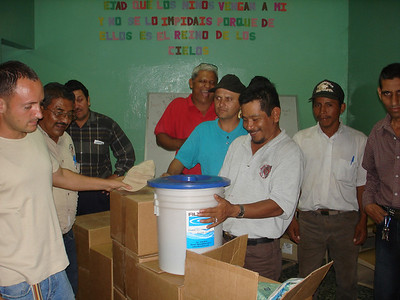Distributing first of the water filters to preachers for their churches