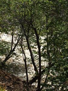 River running at bottom of valley