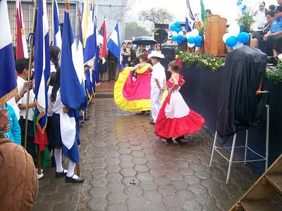 Children performing folk dance in costume for the presentation
