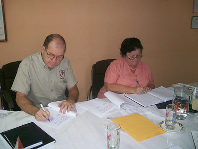 Benny and Senora Moreno reviewing the agreement