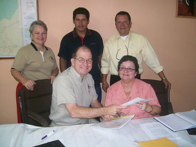 Benny and Senora Moreno exchanging signed copies of the agreement.