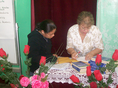 Ann explaining bible lessons to one of the mission's teachers