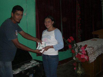 Teacher receiving seeds after completing agricultural seminar on How to Grow a Garden