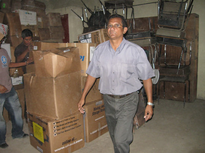 Brother Luis unloading Smile boxes