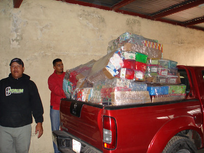 Loading truck with Smile boxes for the kids at Apanas School