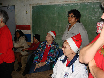 Teacher, Jean and Beverly listening to opening remarks by Donna at St. Inez