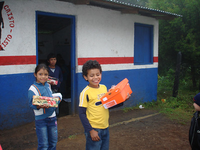 St. Inez kids head home to play with the toys.