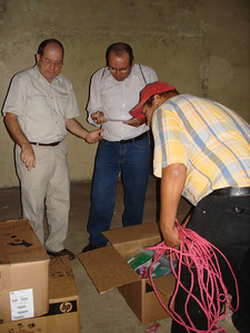 Preacher from Managua signing receipt for the boxes for his congregation