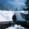 3 - Al shoveling snow off the roof