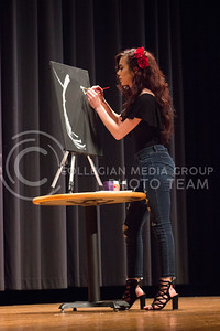 Freshman studying Kinesiology Yulisa Enriquez gives the audience an art performance at the Belliza Latina pageant at Forum Hall on April 22, 2017. (Kelly Pham | The Collegian)