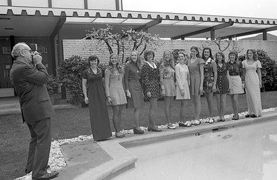 Official Miss Humboldt Pageant photographer Angelo Intersimone, left, took pictures of the 1975 contestants, from left, Pamela Cox, Debbie Lewis, Margie Schierberl, Laura Johnson, Mary Ann Sinnott, Miss Humboldt 1974 Chollana Pepper, Karen Schroeder, Mollie Beasley, Marguerite McVay, Patricia Ingram and Nancie Hubacker, outside of the Eureka Inn prior to the competition. (Times-Standard file photo)