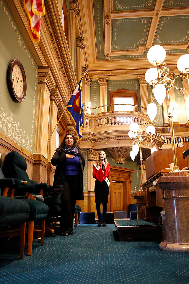 Miss Loveland Valentine Ava McQuade leads the pledge of alligance along side Speaker of the House Crisanta Duran on the House floor at the Colorado State Capitol on Monday, Jan. 12, 2018. (Photo by Lauren Cordova)