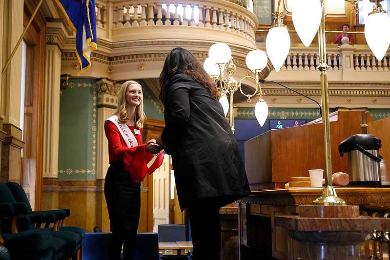 Miss Loveland Valentine Ava McQuade shakes hands with the Speaker of the House Crisanta Duran on the House floor at the Colorado State Capitol on Monday, Jan. 12, 2018. (Photo by Lauren Cordova)