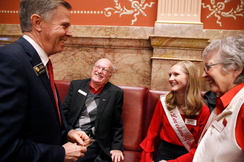 Miss Loveland Valentine Ava McQuade along wiht her chaperones Norma Jean and Chet Gootheart laugh with Senator Kevin Lundberg who honored McQuade on the senate floor at the Colorado State Capitol on Monday, Jan. 12, 2018. (Photo by Lauren Cordova)