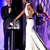 The winner to be of the Miss Ma USA contest, Allissa Latham, 26, of Lowell, picks out a question to be asked by MC, Sal Malafronte waiting on the left. SUN/ David H. Brow