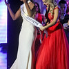 The new Miss Ma 2018, Allissa Latham, 26, of Lowell, is in disbelief after being picked the winner as her shash is being placed by Miss Teen 2017, Caitlyn Martin, 17. SUN/ David H. Brow