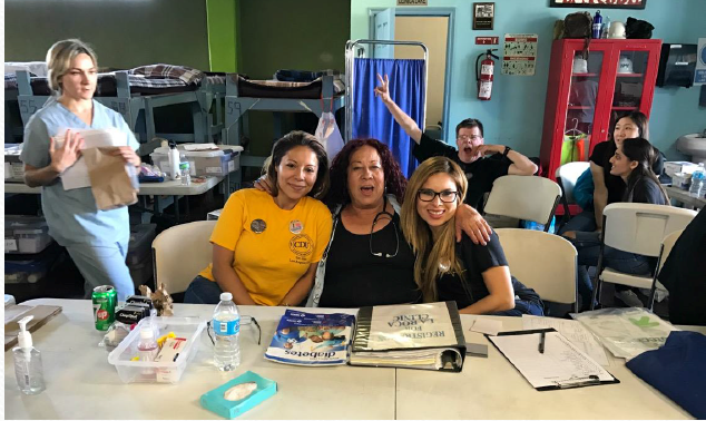 Linda and Perla are at registration with Cuca, a former nurse, who coordinates registration and triages for the patients to see the medical providers, pharmacy, or vitals station.