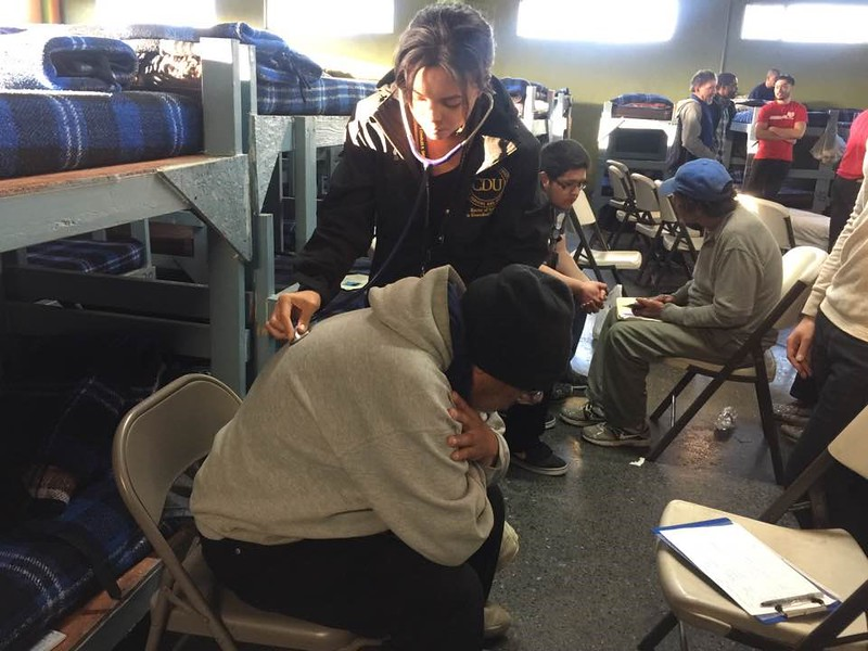Olivia Huerta administers a check up to one of La Roca's homeless men