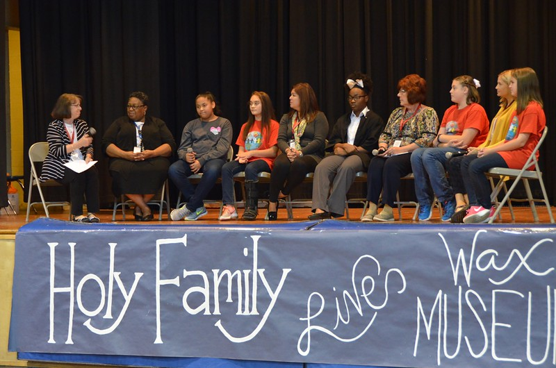 Sr. Cathy leads the first panel of the day: students and staff from Schools in Collaboration.