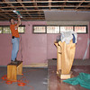 Inside the church putting up sheet rock