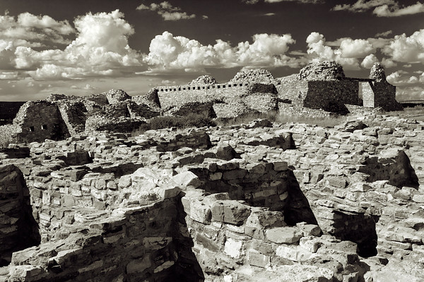 Gran Quivira, Salinas Pueblo Mission, New Mexico. In the Salinas basin stand the weathered ruins of three Puebloan villages and the Spanish colonial missions that make up Salinas National Monument. From about A.D. 1000 to the 1600s, the Puebloan communities of Abó, Quarai, and Gran Quivira (also known as Las Humanas) operated as major centers of trade. Gran Quivira, the largest of the Salinas pueblos, with a population of around 3,000.<br /> <br /> The pueblos were abandoned in the late 1600's because of famine and constant raids by Apache.