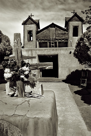 """Santuario de Chimayo, New Mexico. Built in 1813. The dirt in the area is rumored to have healing powers. Many visitors to the church take a small amount of the """"holy dirt"""", often in hopes of a miraculous cure for themselves or someone who could not make the trip. In early days, they often ate the dirt. Now it is customary to rub themselves with the dirt or simply keep it. The Church replaces the dirt in the pocito from the nearby hillsides, for a total of about 25 or 30 tons a year.<br /> <br /> Each year some 300,000 people from all over the world make pilgrimages to the Santuario de Chimayó during Holy Week."""