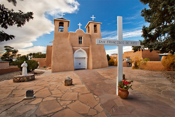 San Francisco de Asis, New Mexico. Construction on the church began around 1772 and was completed in 1815 by Franciscan Fathers and its patron is Saint Francis of Assisi. It is made of adobe as are many of the Spanish missions in New Mexico. It was the subject of paintings by Georgia O'Keeffe and photographs by Ansel Adams and Paul Strand.