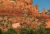 Chapel of the Holy Cross, Sedona, Arizona. Chapel of the Holy Cross, Sedona, Arizona. Conceived by sculptor Marguerite Brunswig Staude in 1932. Her early sketches impressed Lloyd Wright, son of the famous American architect Frank Lloyd Wright, but were not approved by the archbishop of Los Angeles. Her initial ideas for the church changed in 1950 after she saw a church in France designed by the painter Georges Roualt. Lloyd Wright clung to the original plans and refused to work with her. Richard Hein was chosen as project architect, and the design was executed by architect August K. Strotz. It was completed in 1957.