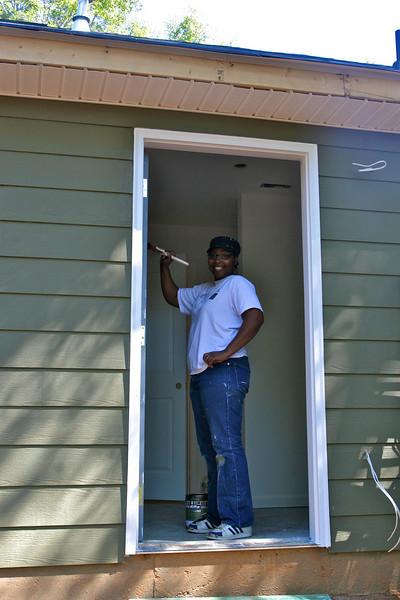 Homeowner Shareka painting her back door.