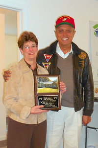 Debbie Sutton with plaque honoring her husband