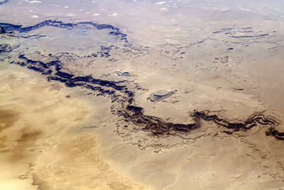 "West of Cairo, there's a large area that looks as though it one had water in it. Here's the ""shoreline"" with many layers of sand. Beautiful."