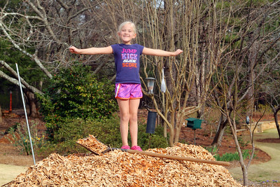 Anne-Gregory onto of the mulch pile. Lachance home by Donna Lachance 001